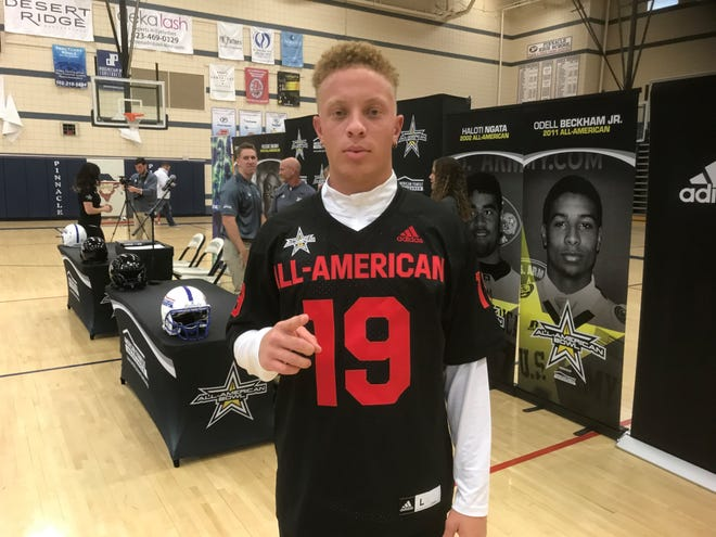 Pinnacle quarterback Spencer Rattler poses with his No. 19 All-American Bowl jersey at his high school.