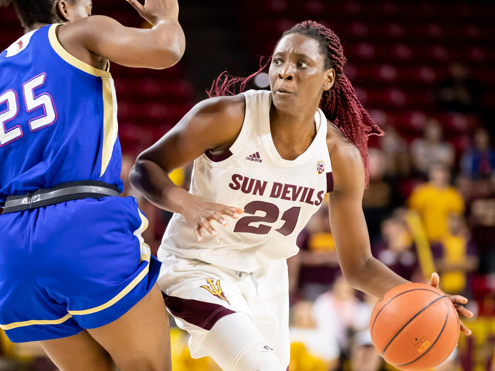 Forward Sophia Elenga (21) of the Arizona State Sun Devils dribbles against Tulsa Golden Hurricane at Wells Fargo Arena on Sunday, December 2, 2018 in Tempe, Arizona.