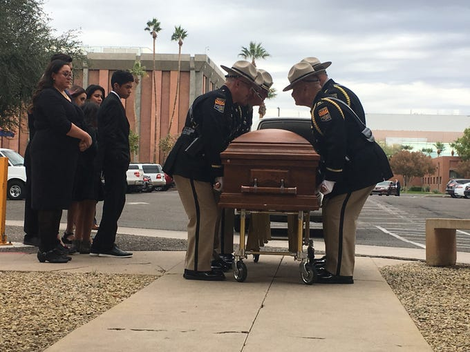 Arizona Department of Public Safety troopers carry the body of former Rep. Ed Pastor at the Arizona Capitol.