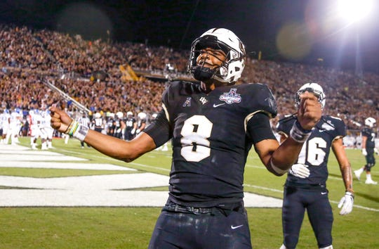 UCF Knights quarterback Darriel Mack Jr. (8) celebrates after a touchdown during the second half against the Memphis Tigers at Spectrum Stadium on Saturday.
