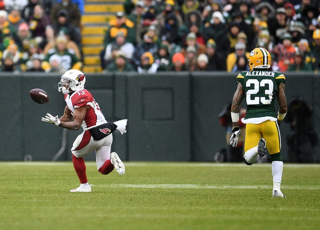Christian Kirk catches a pass in front of Packers cornerback Jaire Alexander during the second half of a game Dec. 2 at Lambeau Field.