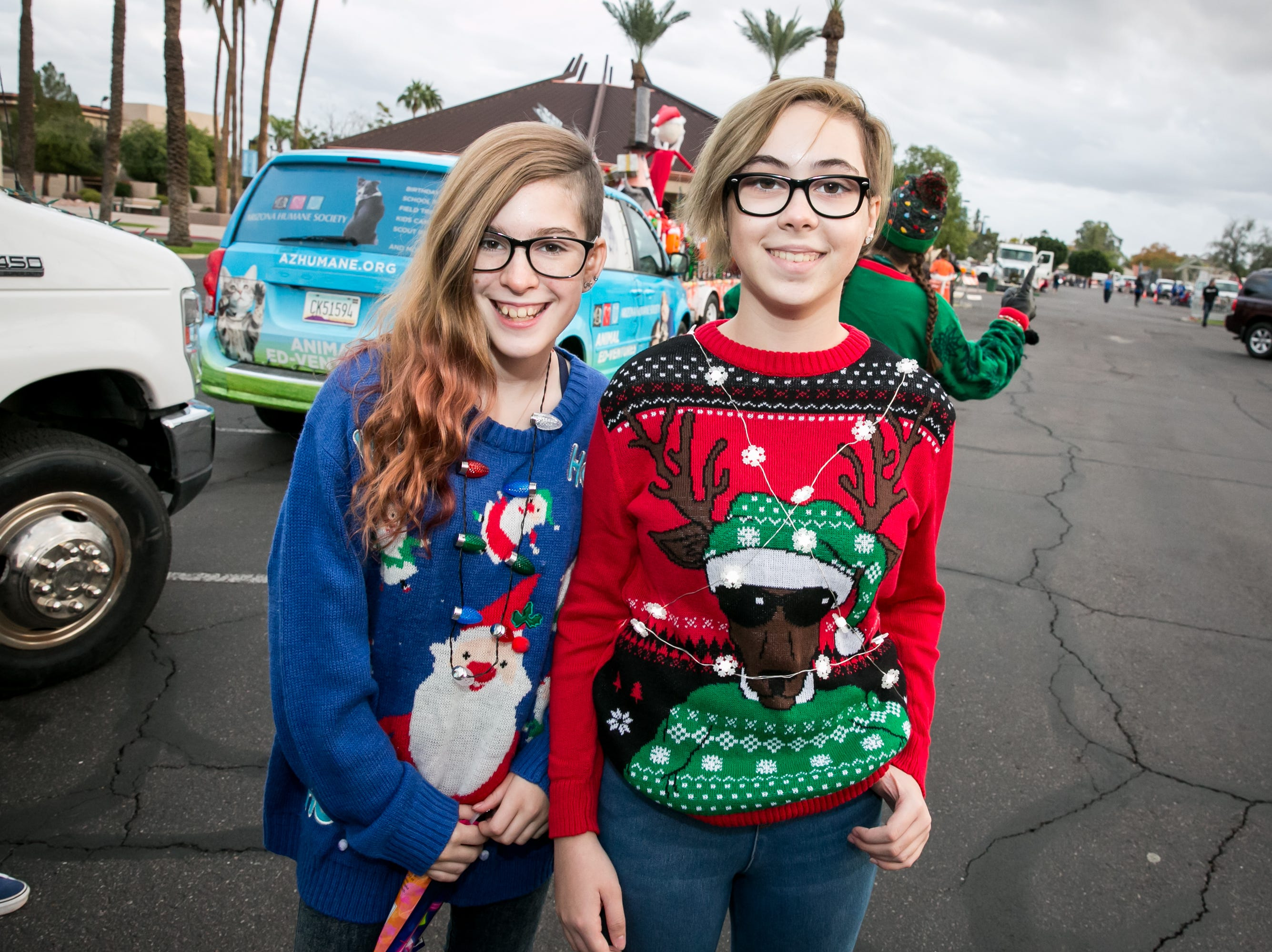 These two had impeccable tastes in holiday sweaters during the APS Electric Light Parade in Central Phoenix on Saturday, December 1, 2018.