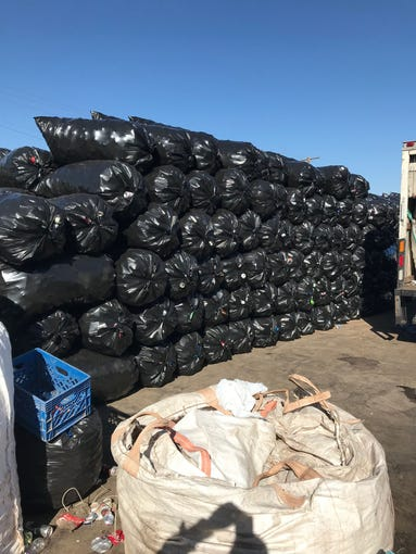 Nearly 30,000 pounds of cans and bottles were recovered after warrants were served at several locations around the Phoenix area associated with the recycling scheme.