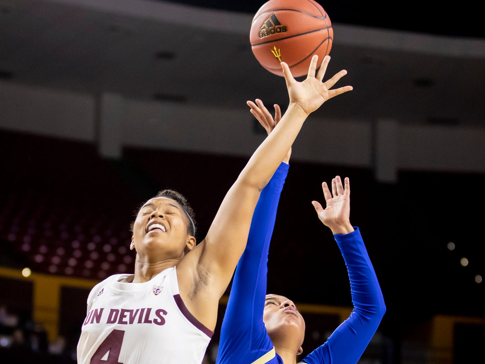 Guard Kiara Russell (4) of the Arizona State Sun Devils and guard Rebecca Lescay (21) of Tulsa Golden Hurricane reach for a rebound at Wells Fargo Arena on Sunday, December 2, 2018 in Tempe, Arizona.
