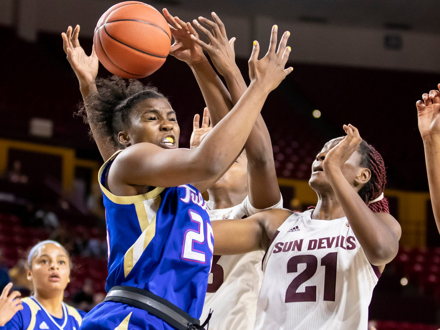 Forward Tyjae' Scales (25) of Tulsa Golden Hurricane reaches for a rebound against the Arizona State Sun Devils at Wells Fargo Arena on Sunday, December 2, 2018 in Tempe, Arizona.