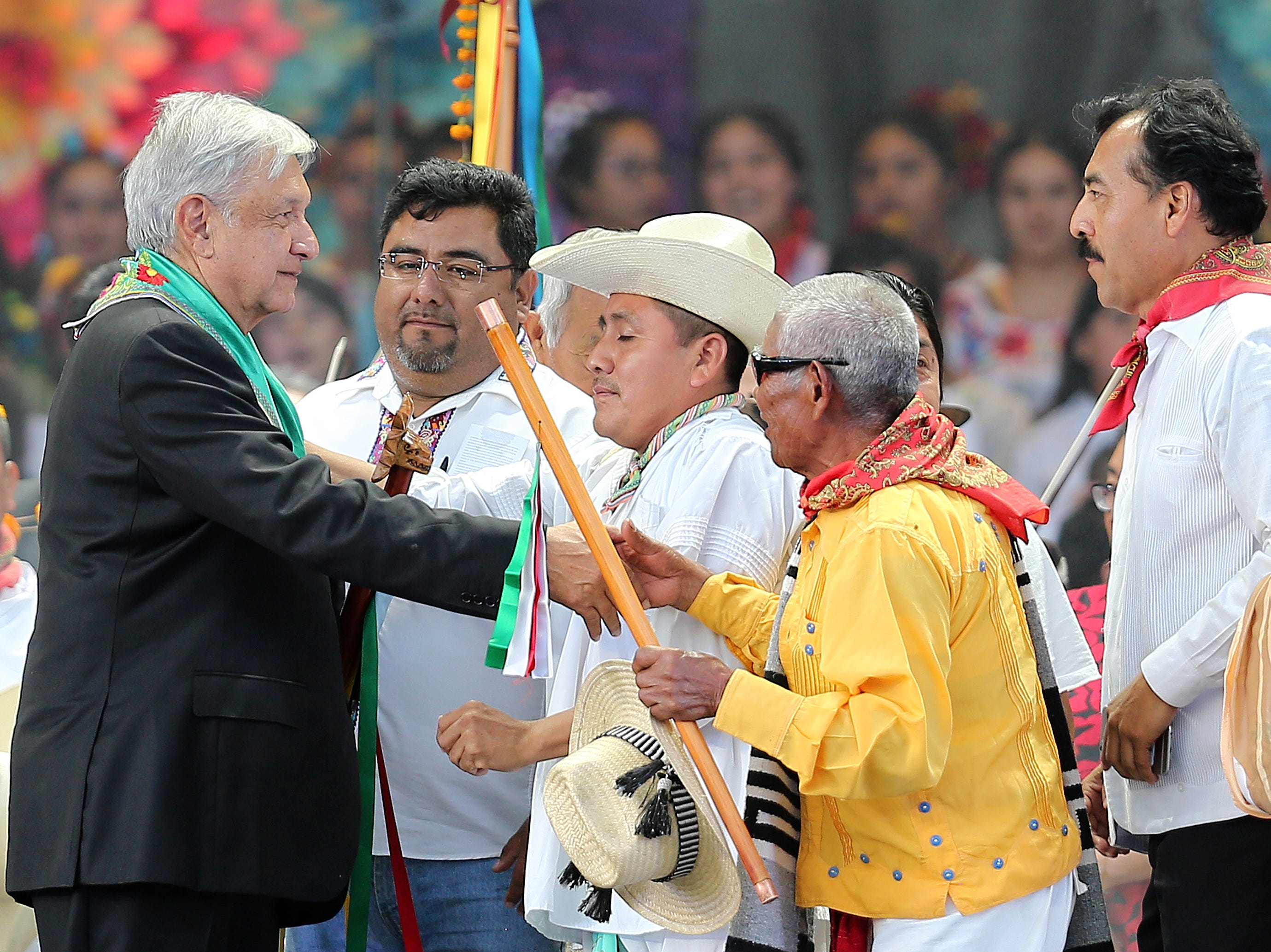 MEXICO CITY, MEXICO - DECEMBER 01: Andres Manuel Lopez Obrador (L), President of Mexico talks to members of the original towns during the events of the Presidential Investiture as part of the 65th Mexico Presidential Inauguration at Zocalo on December 01, 2018 in Mexico City, Mexico. (Photo by Manuel Velasquez/Getty Images)
