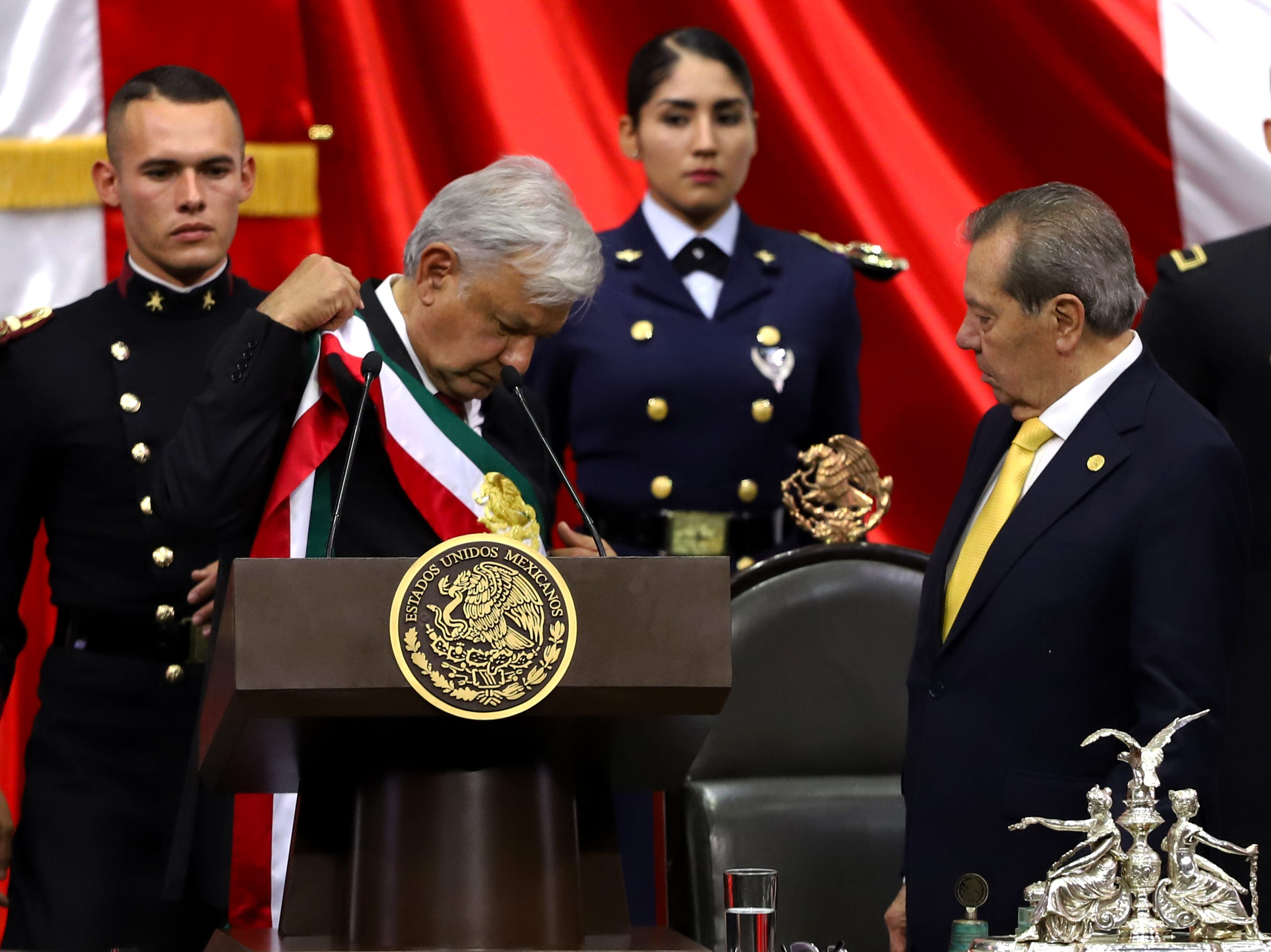 MEXICO CITY, MEXICO - DECEMBER 01: Newly appointed Mexican President Andres Manuel Lopez Obrador receives the presidential sash from President of the Chamber of Deputies Porfirio Munoz Ledo (L) during the events of the Presidential Investiture as part of the 65th Mexico Presidential Inauguration at Congress of the Union on December 01, 2018 in Mexico City, Mexico. (Photo by Getty Images/Getty Images)