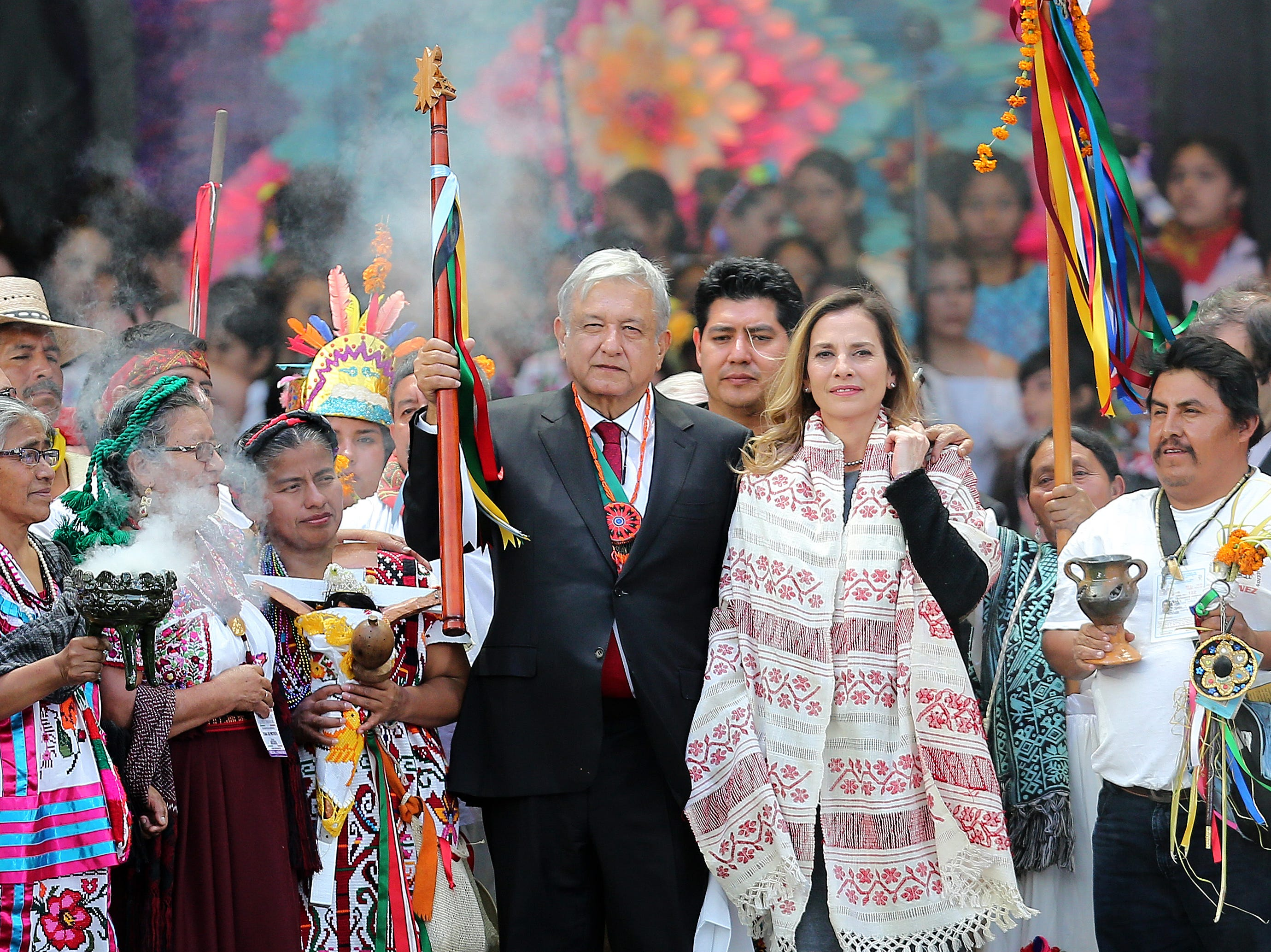 MEXICO CITY, MEXICO - DECEMBER 01: Andres Manuel Lopez Obrador (L), President of Mexico poses with the baton alongside his wife Beatriz Gutierrez during the events of the Presidential Investiture as part of the 65th Mexico Presidential Inauguration at Zocalo on December 01, 2018 in Mexico City, Mexico. (Photo by Manuel Velasquez/Getty Images)
