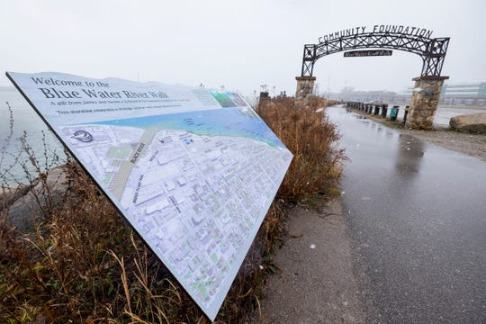 Snow falls on the Blue Water River Trail Monday, Dec. 3, 2018 in Port Huron. The county has hired two consultants to look at filling the gaps in the Bridge-to-Bay Trail, Great Lakes to Lake Trail and the Wadhams-to-Avoca trail.