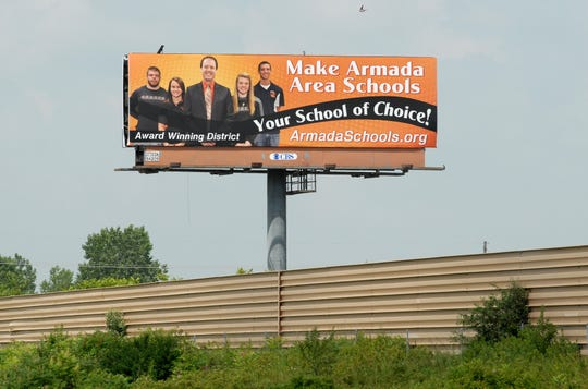 A billboard touts Armada Area Schools east of the Capac Road exit on Interstate 69 in the Capac district, pictured on June 27, 2013.