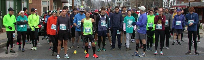 Runners prepare to start the Knights of Columbus Holiday Run in Wappingers Falls on Saturday.