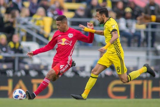 New York Red Bulls midfielder Tyler Adams kicks the ball while Columbus Crew SC midfielder Artur  defends at Mapfre Stadium in November.