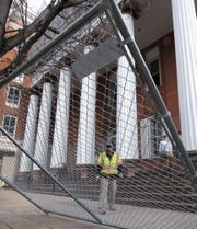 A fence is being installed around the perimeter of Franklin County Courthouse. The county is paying Lycoming Supply of Williamsport nearly $1.3 million to demolish buildings and prepare a site in the first block of North Main Street for the Franklin County Judicial Center and the former Sheetz building on North Second Street.  Franklin County Commissioners bought the 8-foot-tall fence that Long Fence is installing.  It cost $20,975.