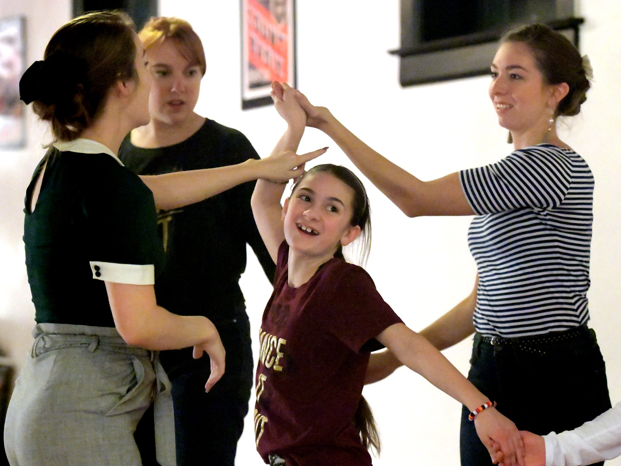 Sasha Malone, 11, of Manchester Township, center, practices a dance routine during a Vintage Chorus Line class at Victrola Dance Hall in York City Tuesday, Nov. 20, 2018. She was joined by, from left, Victrola Dance Hall owner and instructor Randi Stauffer and Jennifer Reddig and Mary Ludwig, both of Lititz. Bill Kalina photo
