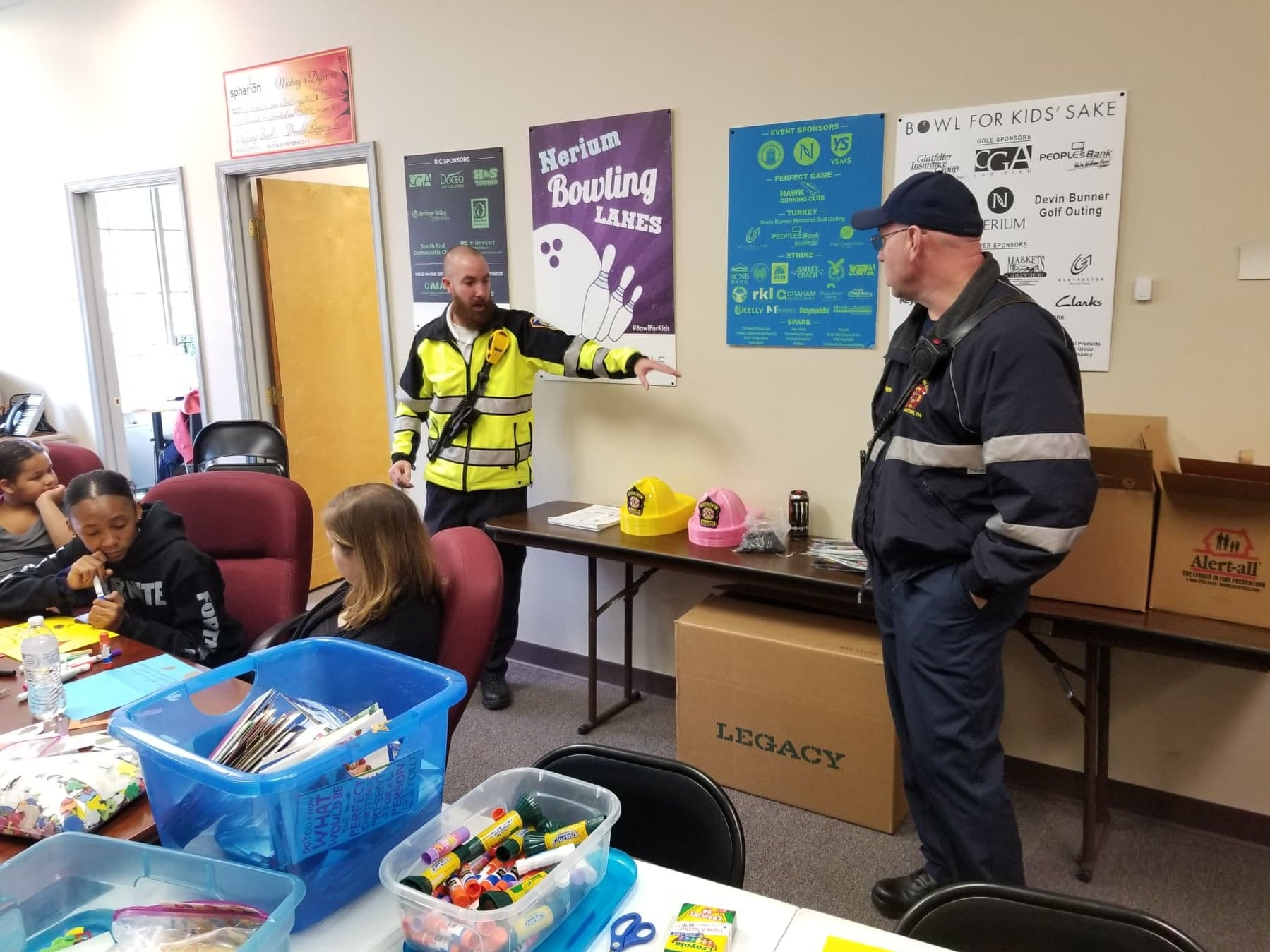 On November 17, 2018, Bigs and Littles in Big Brothers Big Sisters of York & Adams CountiesÕ mentoring programs participated in 10,000 Acts of Kindness. Matches met at Big Brothers Big SistersÕ office in downtown York to make thank you letters to be sent to volunteer firefighters in the county and California, who have been fighting disastrous wildfires. Members from Rescue Fire Company No. 1 in Dallastown came to the event to talk about their work, give fire safety advice, and answer questions. submitted