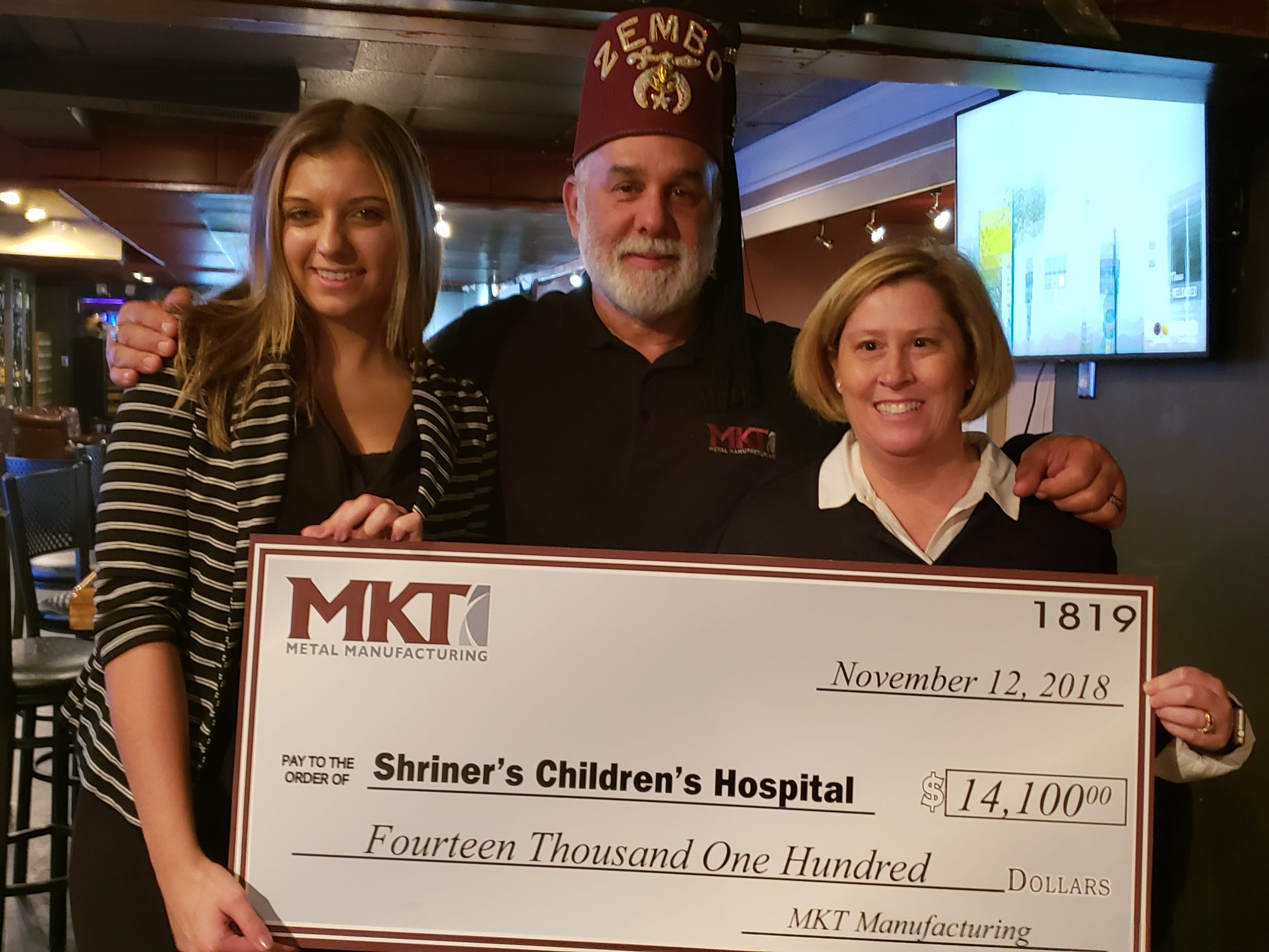 MKT Metal Manufacturing met at The Cove Restaurant with the York County Shrine Club to present the check to a Philadelphia hospital representative November 12th, 2018. Funds were raised through MKTÕs annual sporting clays fundraiser held on September 28th at Warrington Sporting Clays in Wellsville, PA. The Shriners Hospitals for Children¨ is a network of 22 non-profit medical facilities all across the United States that treat orthopedics, burn, cleft lip and plate, and spinal injuries at no cost to the family regardless of insurance status. Pictured are, from left, Samantha Melhorn, Marketing Specialist at MKT, Ken Brown, Shriner and President/CEO of MKT and Bonnie Meister, Development Officer for Shriners Hospitals - Philadephia. submitted