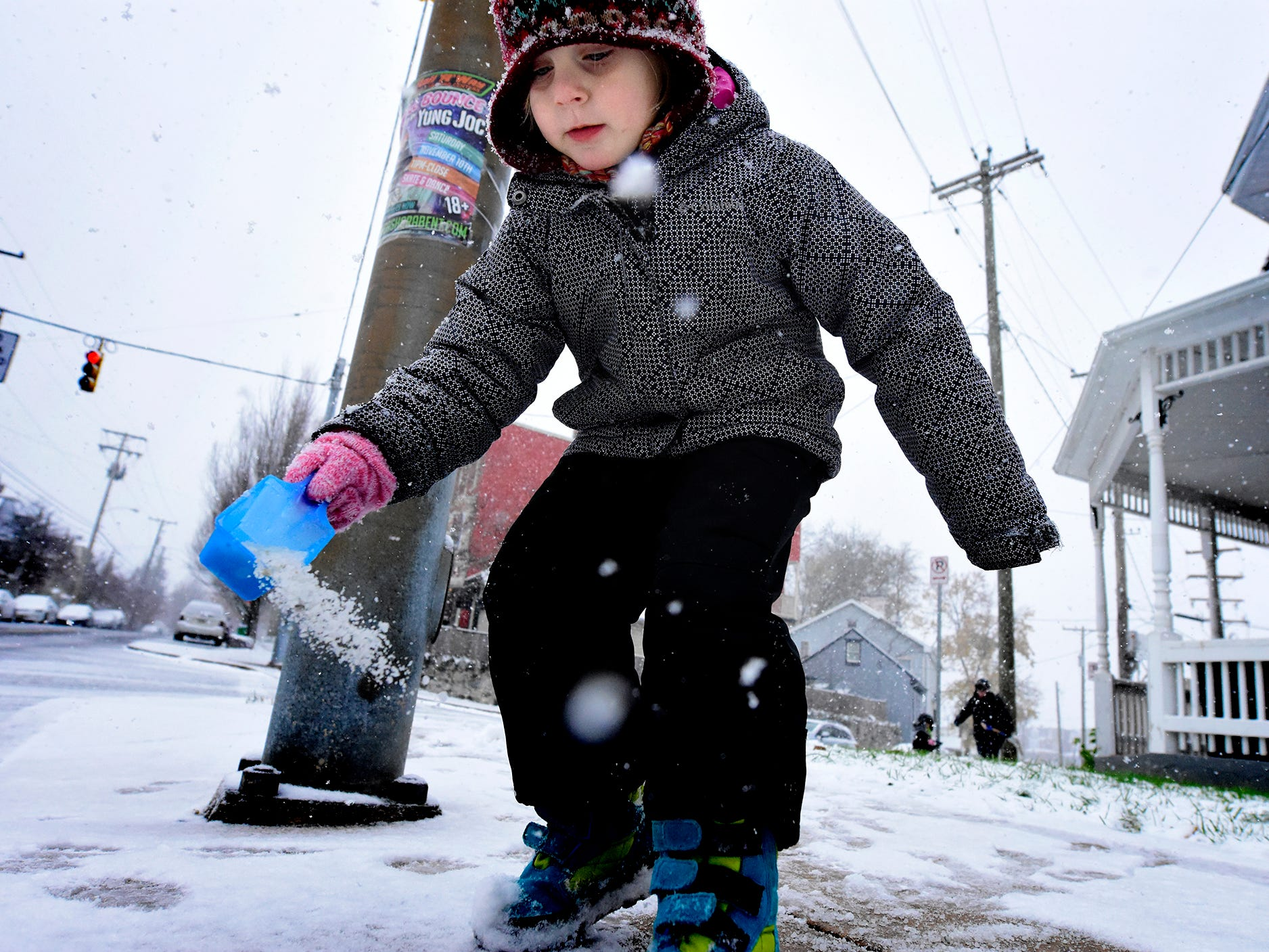 Rosie Nowak, 4, spreads salt while clearing sidewalks with  her mother Ellie and brother Anthony, 2, outside their home along Hamilton Ave. in York City Thursday, Nov. 15, 2018. Ellie said it was her children's first snow shoveling experience. Parts of York County could get as much as 6-7 inches of snow according to forecasters. Bill Kalina photo