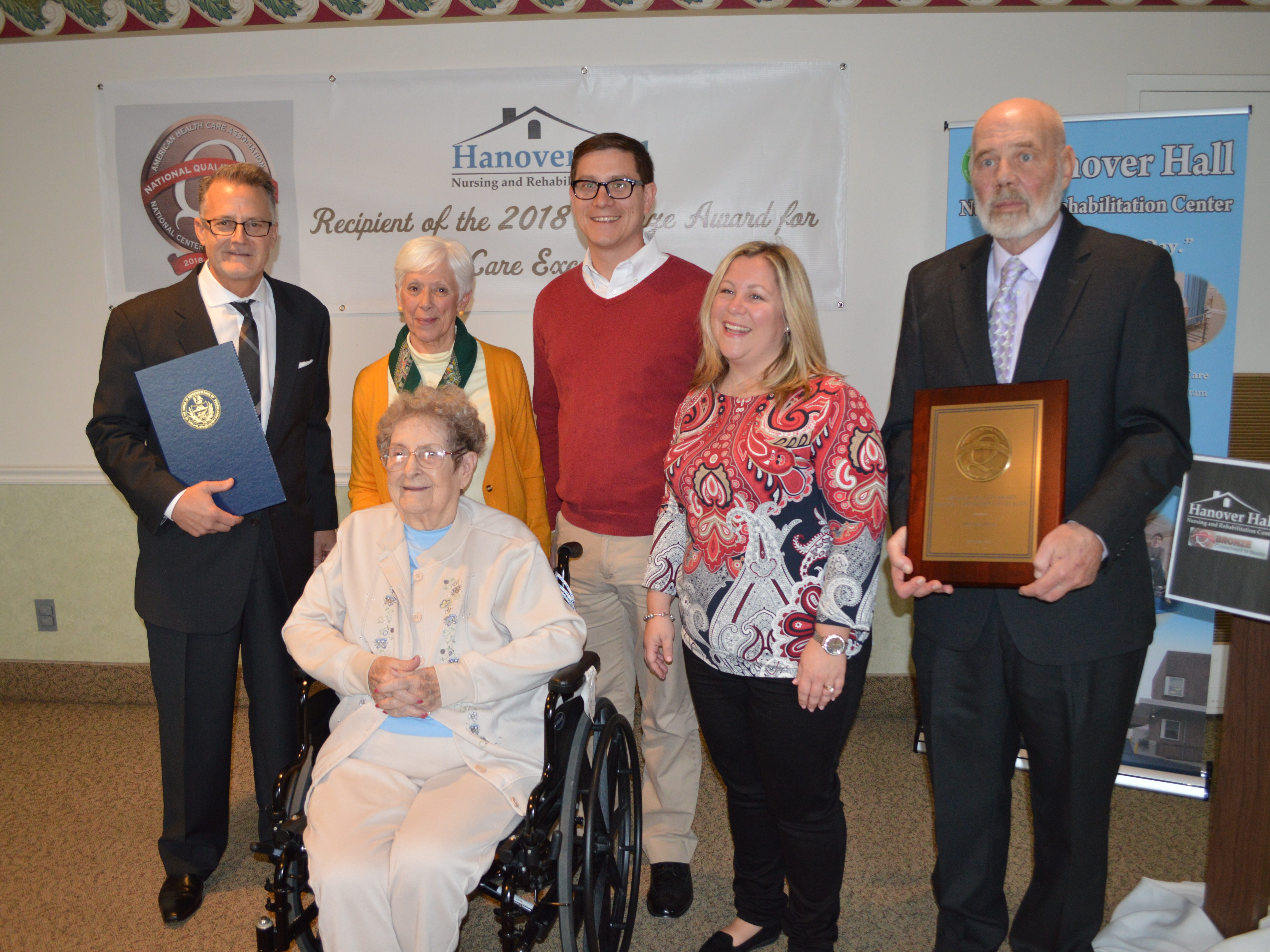 Hanover Hall Nursing and Rehabilitation Center in Hanover, Pa., was honored as a 2018 Bronze Achievement in Quality Award recipient by the American Health Care Association and National Center for Assisted Living (AHCA/NCAL). From L to R: Daniel Pyle Administrator, Hanover Hall; Barb Metzler, on behalf of Sen. Rich Alloway; Resident, Pat Wentz; Rep.Torren Ecker; Rep. Kate Klunk; Tom Sugars, Vice President of Human Resources, WILMAC Corporation. submitted