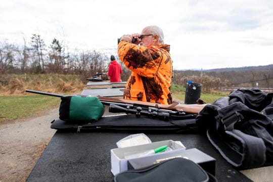 Rick Sipe, of Cumberland County, looks at his target while he sights-in his rifle at the range on State game lands 242, in Warringtown Township, Monday, Dec. 3, 2018. Sipe harvested an 8-point buck on Nov. 27, but had his rifle fall and knock the scope thereafter, so he was out sighting it back in before going after a doe.