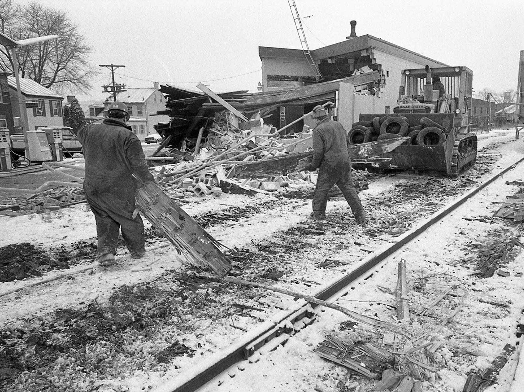 Debris is pulled off the tracks. In December 1989, a train left the tracks near Arch Street and North George Street in York and destroyed Ellis Service.