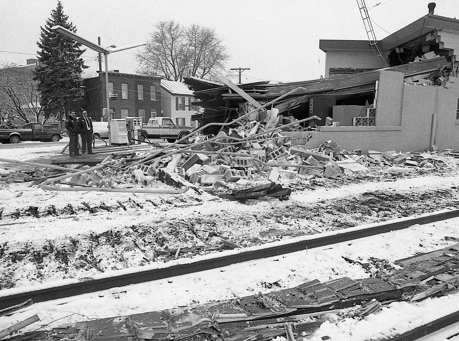 In the background at left is now PeoplesBank Park. In December 1989, a train left the tracks near Arch Street and North George Street in York and destroyed Ellis Service. Ellis Brothers moved to Smith Street in York is in business today.