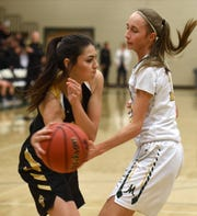 Galena's Kiana Arvizo passes the ball around Manogue's Jordyn Jensen after getting a the rebound last season.