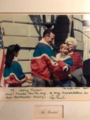 Two-time Olympic gold medal short-track speedskater Cathy Turnerof Parma shares a laugh with President George H.W. Bush during White House visit in 1992 following the Albertville Games. After handing Mr. Bush his honorary Olympic jacket, Turner fixed his collar and they hugged. He sent her a hand-written note later saying, 'Wow! Thanks for the hug.'