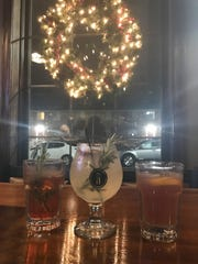 Holiday cocktails, from left to right: Cran-Mary Bourbon, Holiday Lemonade, and Lou-Bob