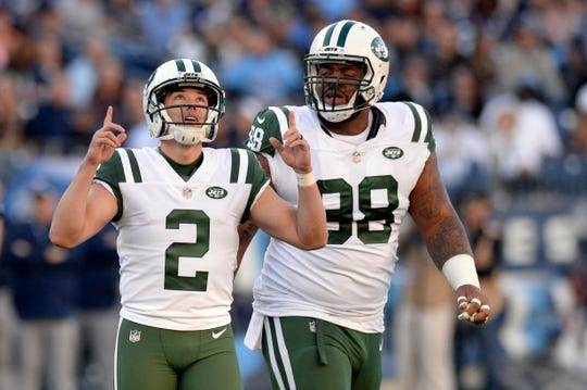 New York Jets kicker Jason Myers (2) celebrates after kicking a 54-yard field goal against the Tennessee Titans.  Myers was 5 for 5. You know it's bad when the kicker is leading candidate for team MVP.
