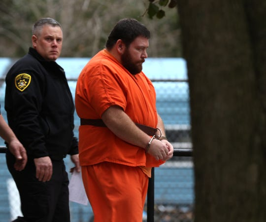Bron Bohlar,34,  is brought into Wayne County Court. He plead  guilty to a conspiracy charge in connection with the Oct. 22 shooting deaths of Joshua Niles and Amber Washburn.