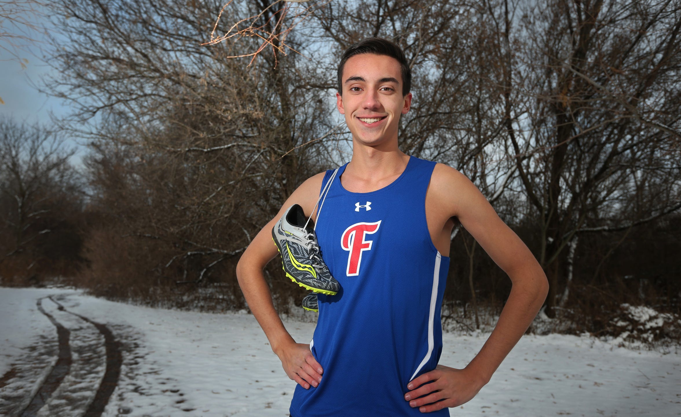 Sean Henretta, senior at Fairport High School, is the All Greater Rochester boys cross country athlete of the year for 2018.  Henretta is seen on the Fairport varsity cross country course in Center Park in Fairport.