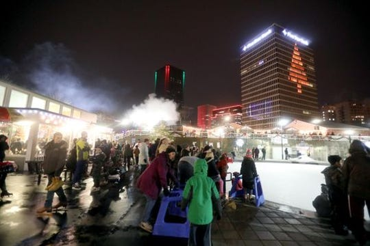 Opening night of the ROC Holiday Village drew a crowd. And they were hungry and thirsty.