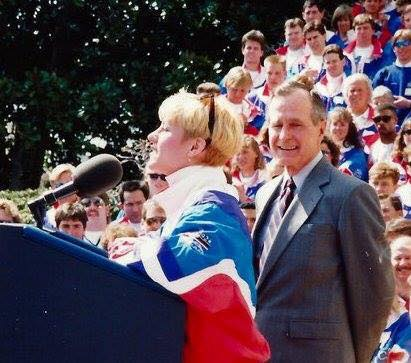 Gold medal speedskater Cathy Turner of Rochester gives a speech on behalf of her fellow Olympians at the White House in 1992, hosted by President H.W. Bush. The lectern was too tall for Turner, so during her talk, the president handed her a step stool.