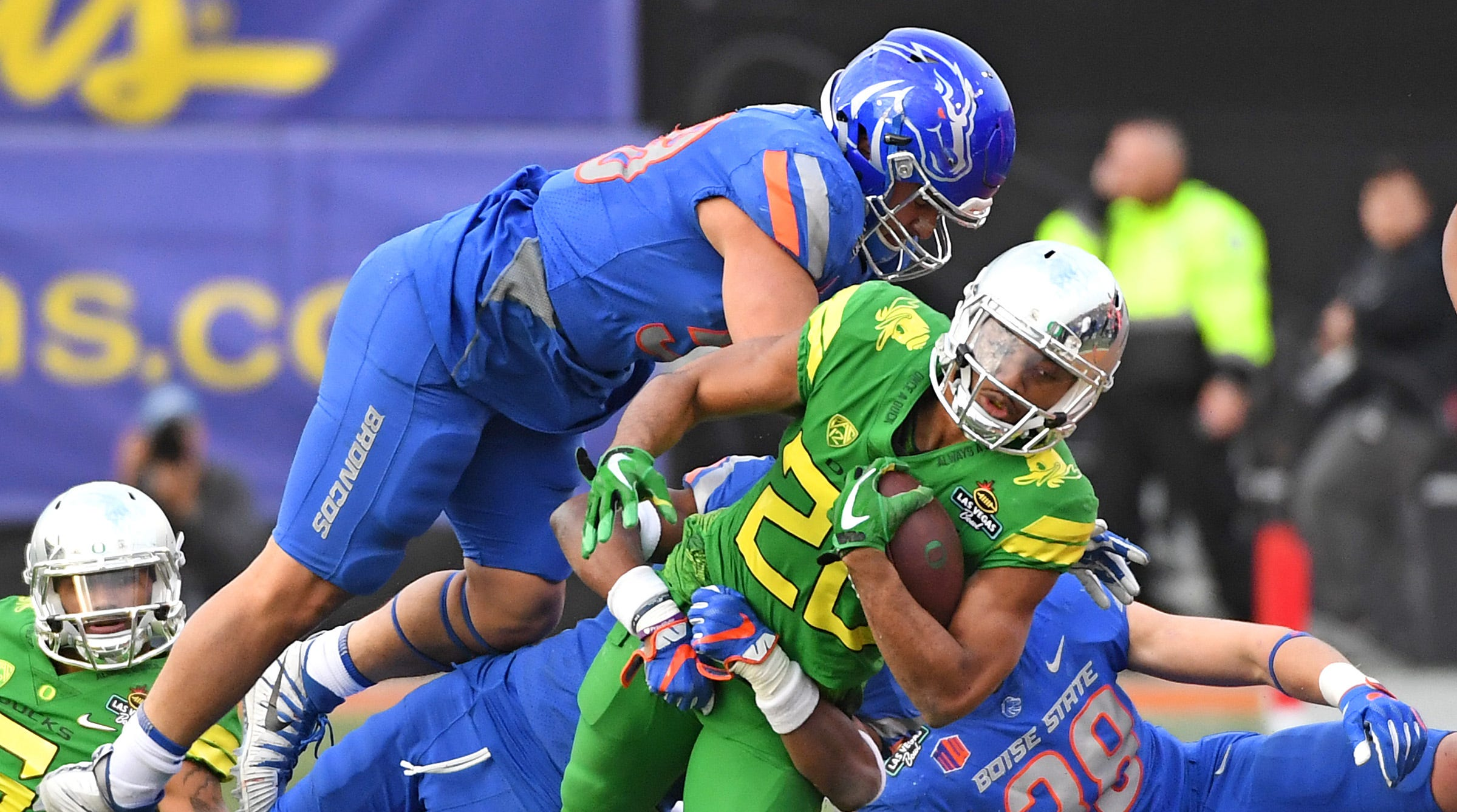 Dec 16, 2017; Las Vegas, NV, USA; Oregon running back Tony Brooks-James (20) is knocked out of bounds by Boise State linebacker Tyson Maeva (58) during the second half of the 2017 Las Vegas Bowl at Sam Boyd Stadium. Boise State won 38-28.