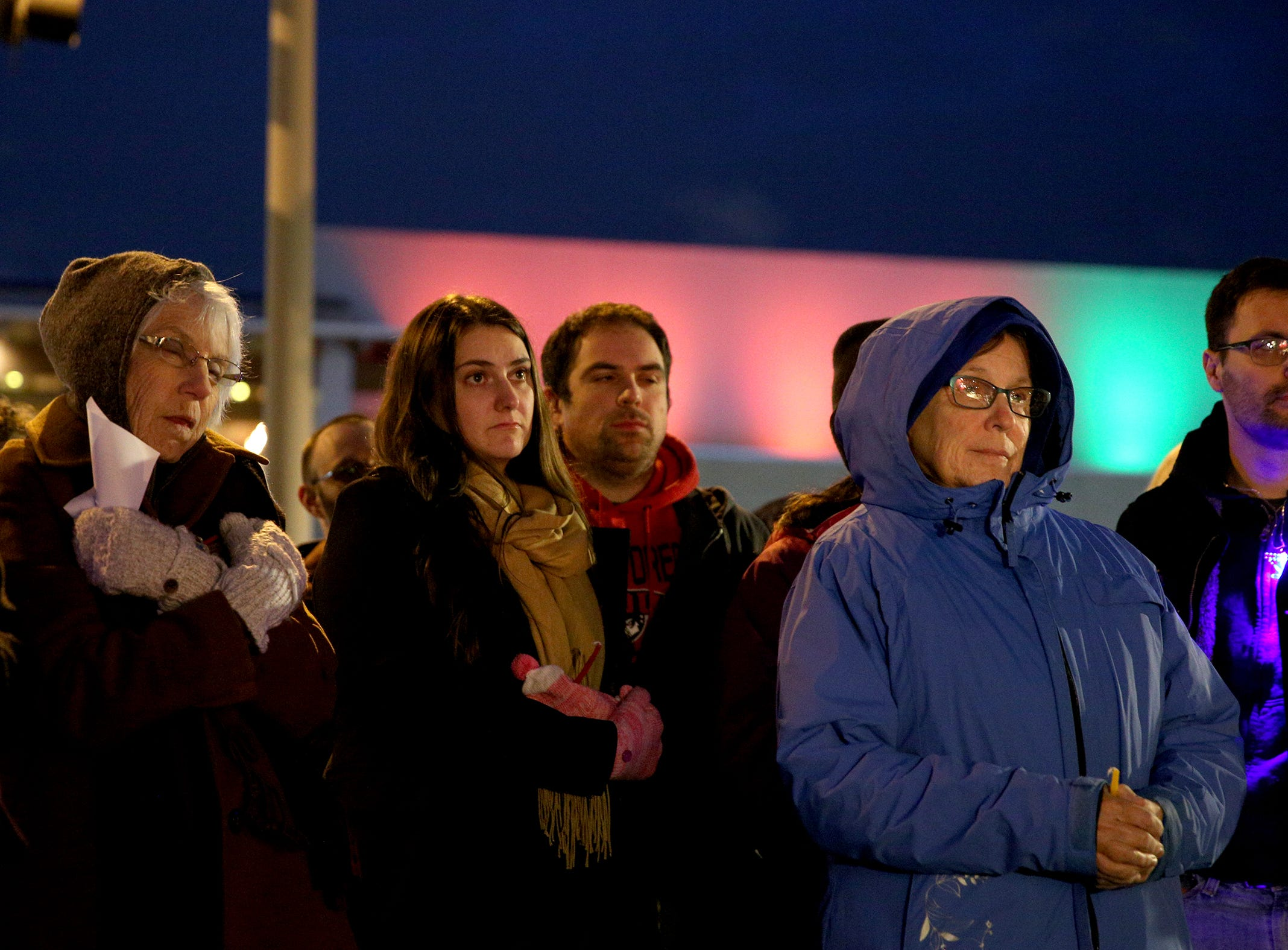 Attendees listen to Rabbi Avrohom Perlstein during a celebration on the first day of Hanukkah at Mirror Park in downtown Salem on Sunday, Dec. 2, 2018.
