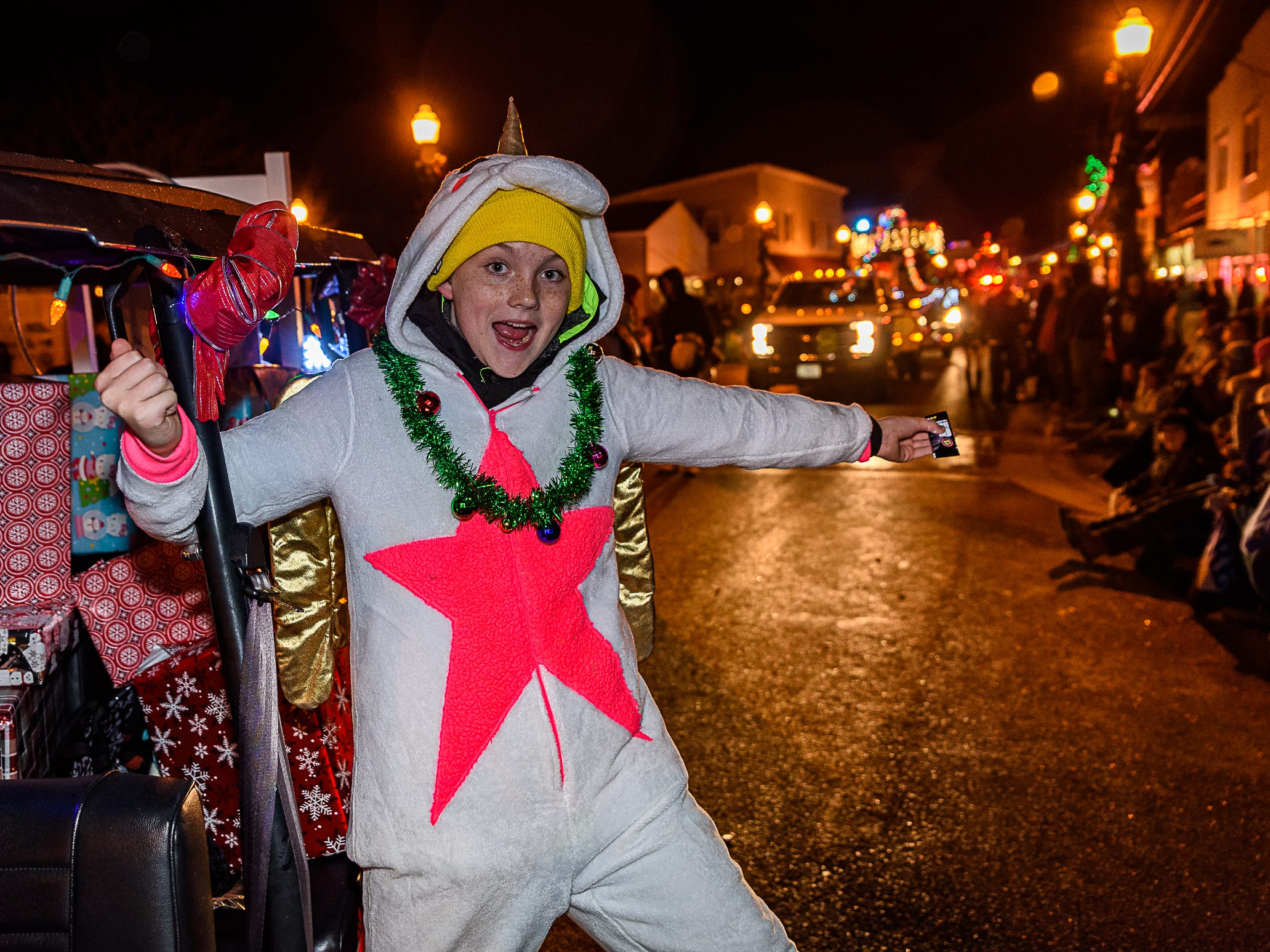 A member of the local Girl Scout Troop enjoy strikes a pose during the Christmas parade on Saturday, Dec. 2.