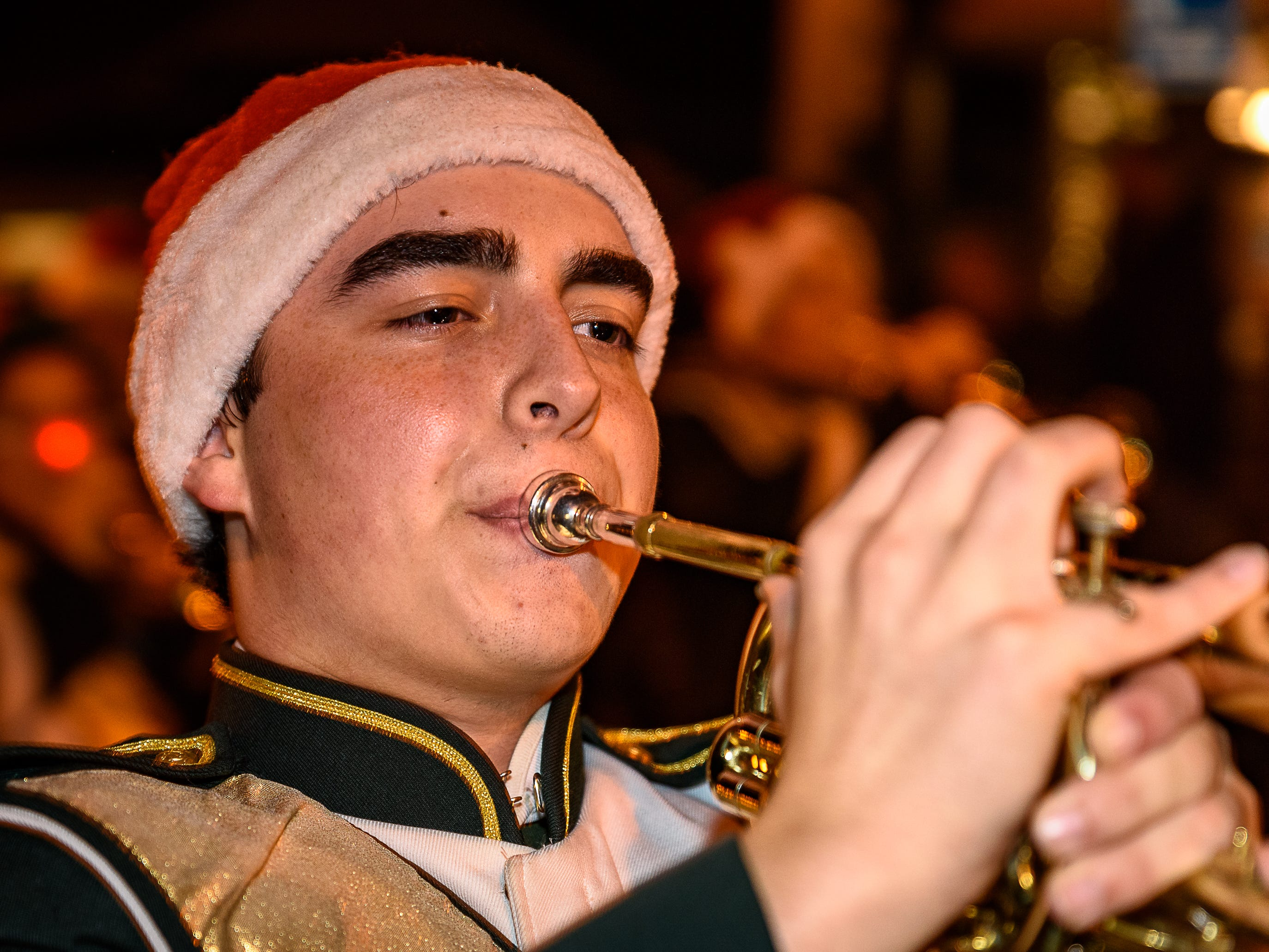 A member of the Indian River High School marching band from Delaware performs in the Chincoteague Christmas parade on Dec. 1.
