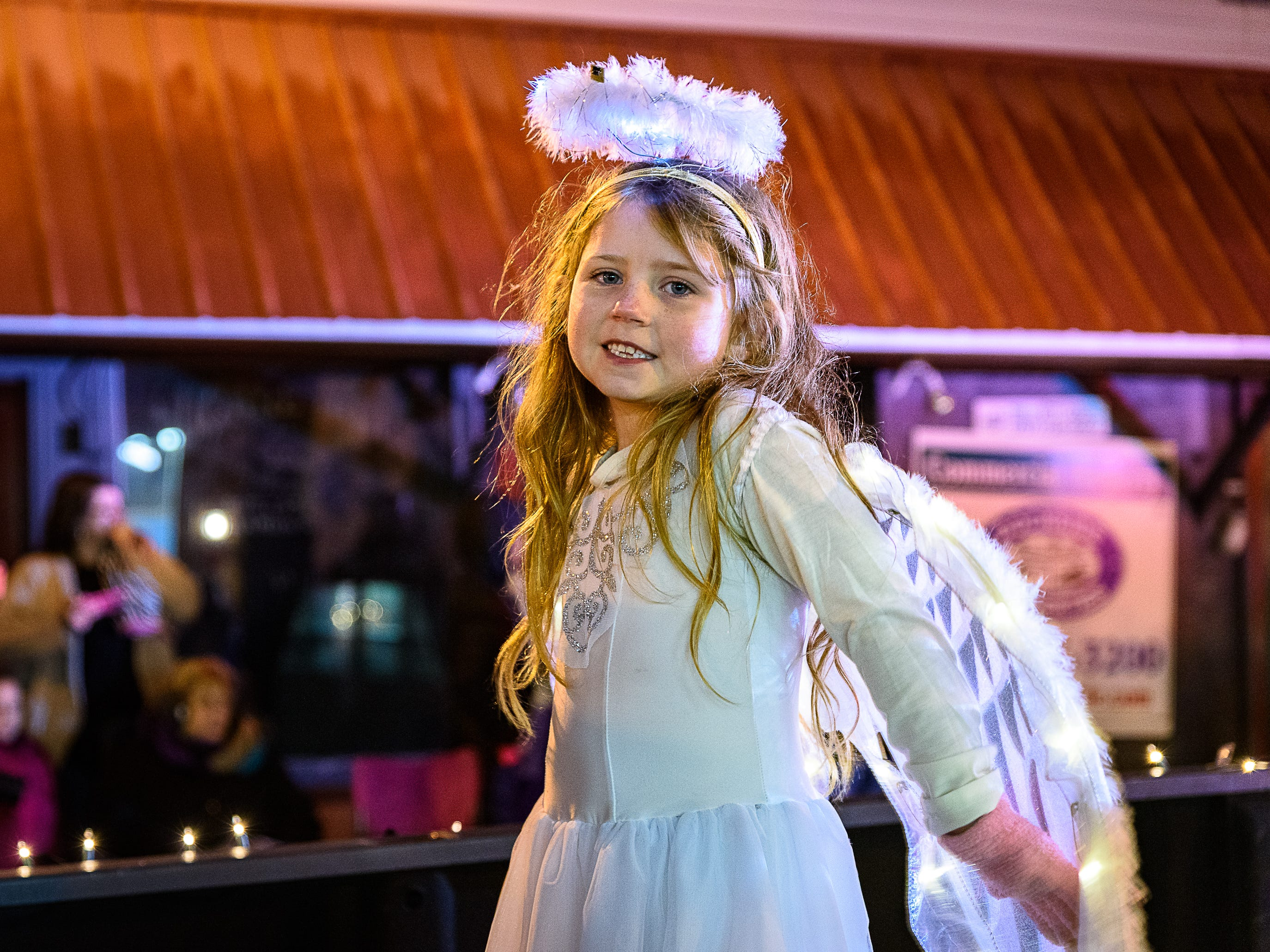 A young angel rides atop a float in the Chincoteague Christmas parade.