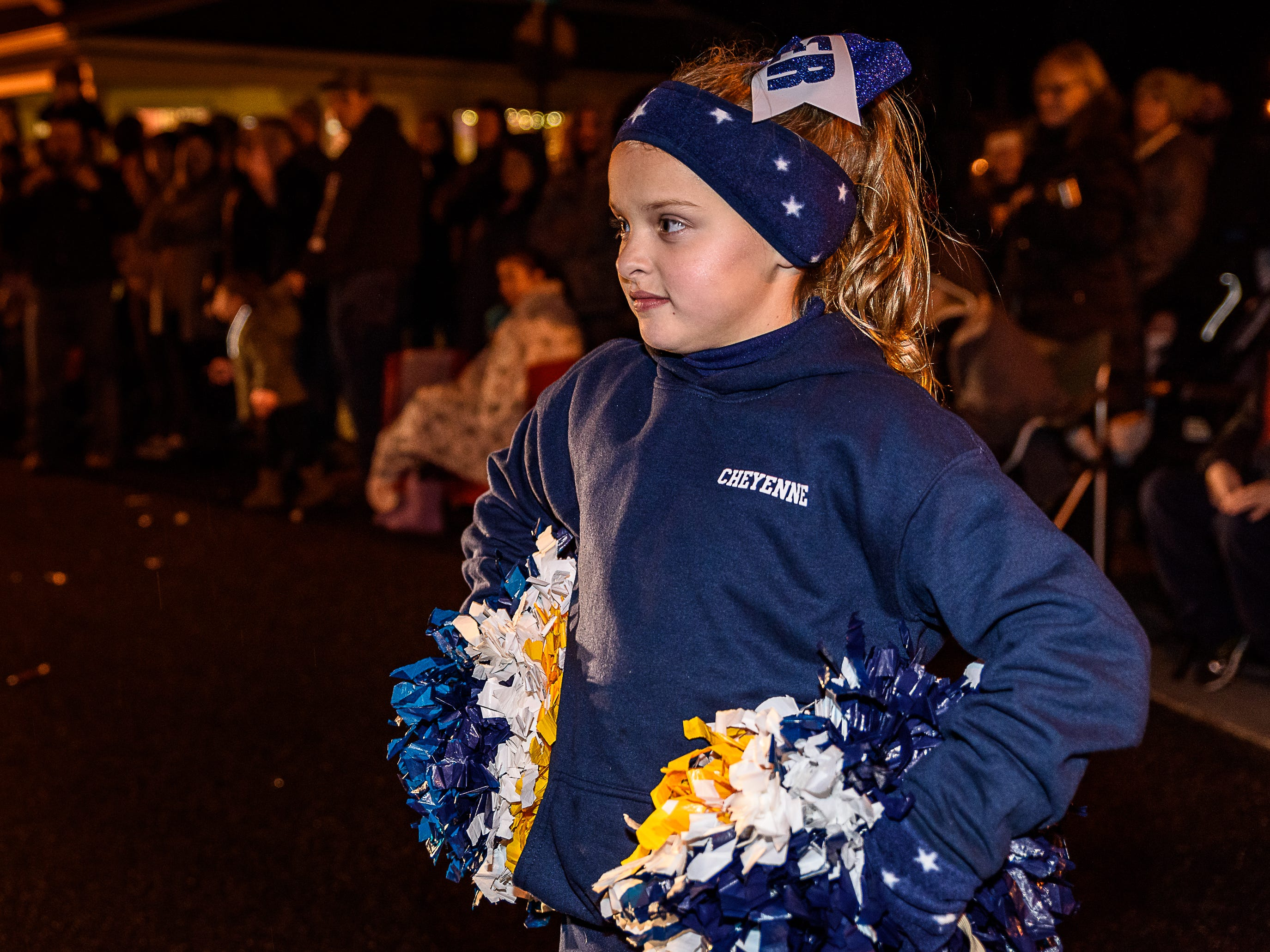 A member of the North Accomack Youth Football & Cheerleading squad gets ready to start her routine during the Chincoteague Christmas parade.