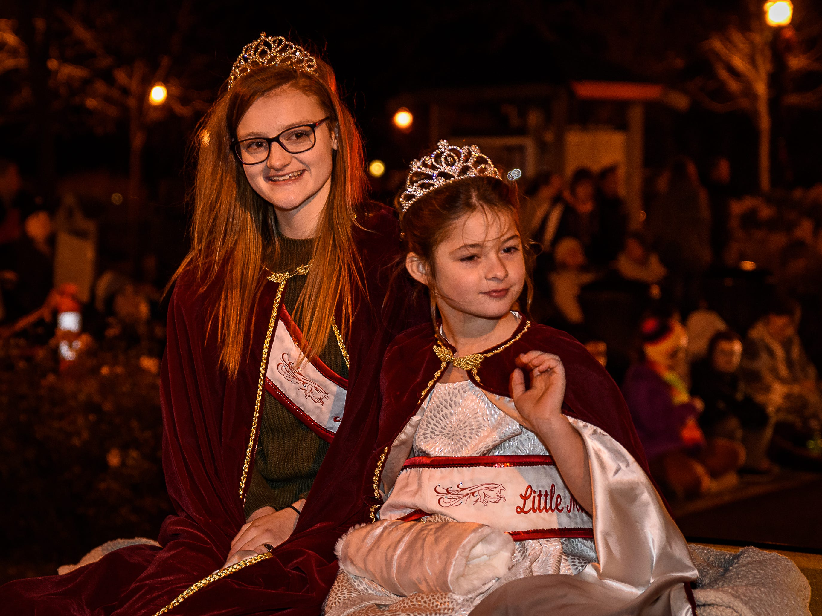 Miss Chincoteague and Little Miss Chincoteague ride in the Christmas parade.
