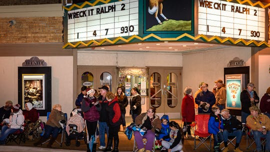 """Spectators line the sidewalks outside The Island Theater waiting for the annual Chincoteague Old-fashioned Christmas Parade to start on Saturday, Dec. 1.  The parade featured fire trucks and rescue units, equestrian groups, decorated boats, shiny classic cars, marching units and floats. The theme this year was  """"Chincoteague is for Christmas Lovers."""""""