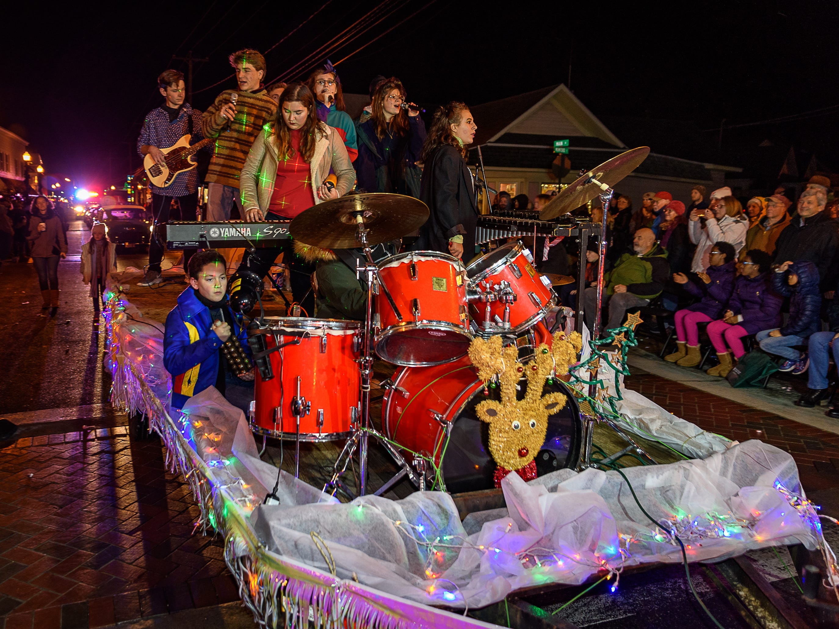 Members of the Chincoteague High School band ride on a float during the annual Christmas parade.
