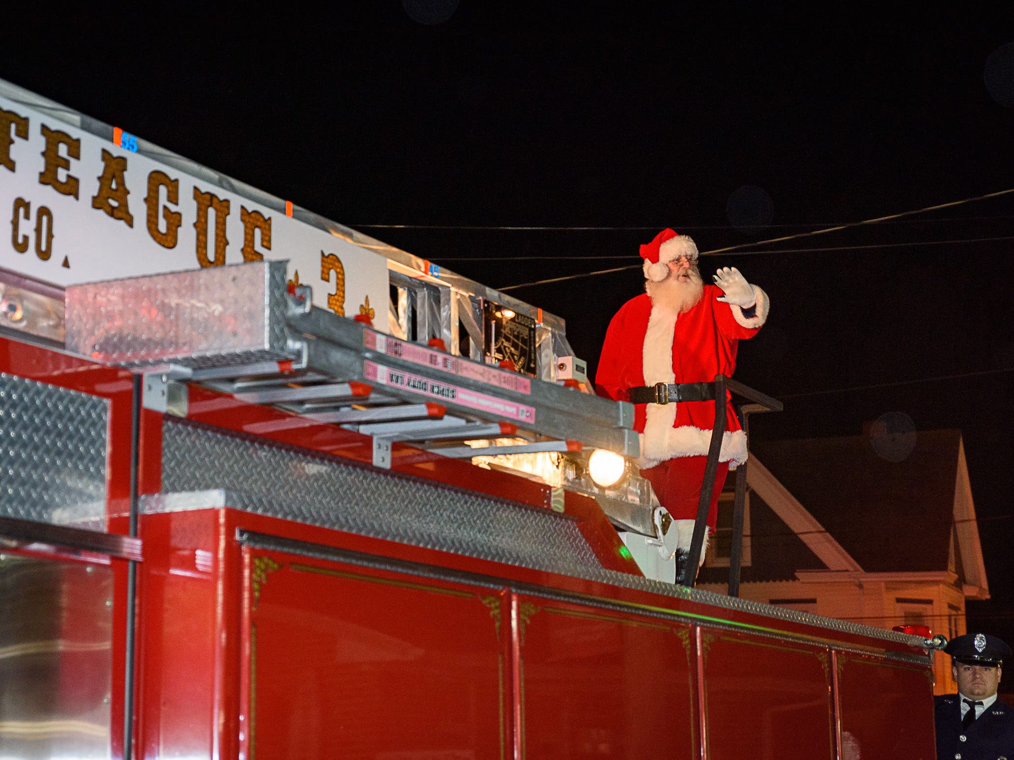 Santa rides atop Chincoteague Volunteer Fire Company's Ladder 3 at the town's Christmas parade on Saturday, Dec. 1.