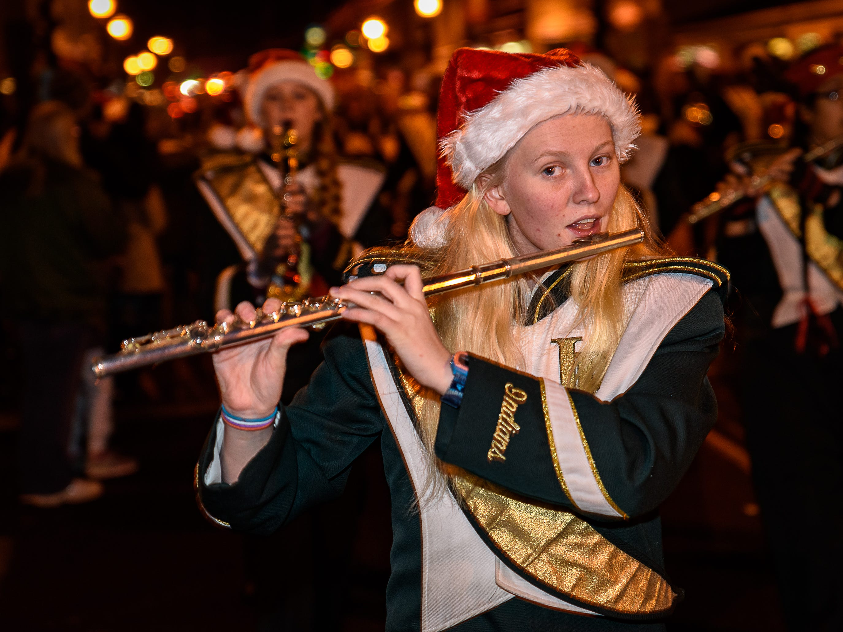 A flute player from the Indian River High School marching band from Delaware performs at the Chincoteague Christmas parade.