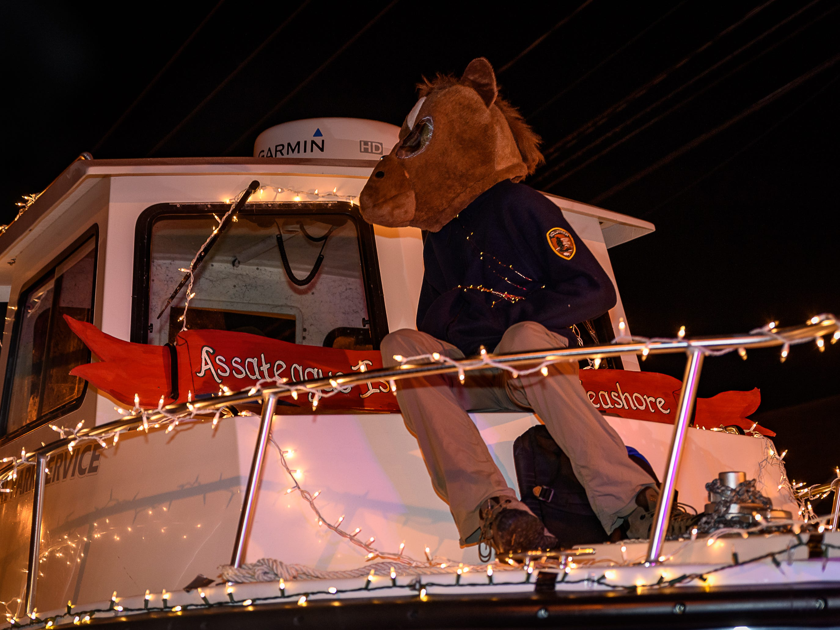 The mascot of the Assateague Island National Seashore rides atop their float in the Chincoteague Christmas parade on Saturday.