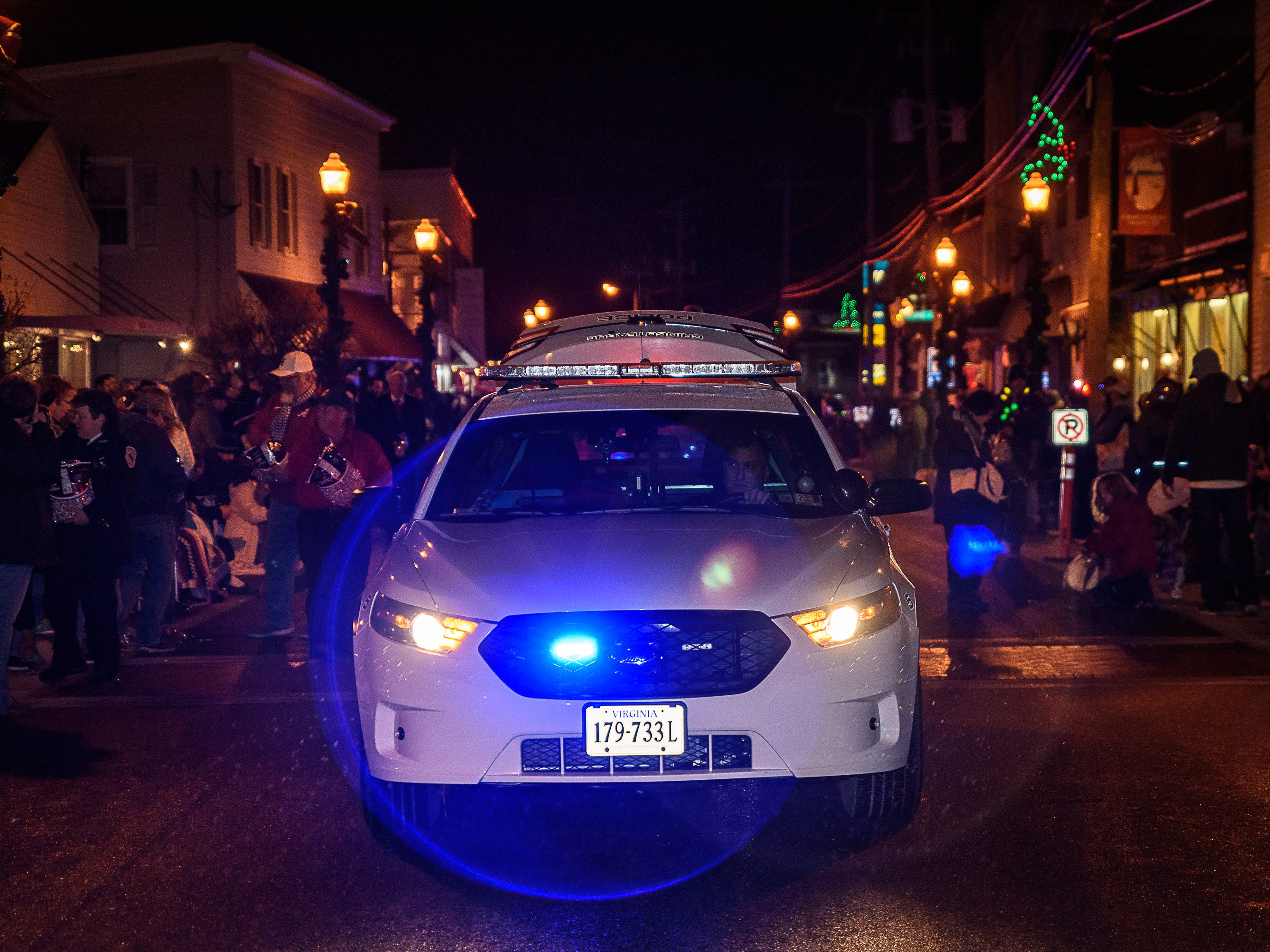 A Chincoteague Police Department car leads the annual Christmas parade on Dec. 1.