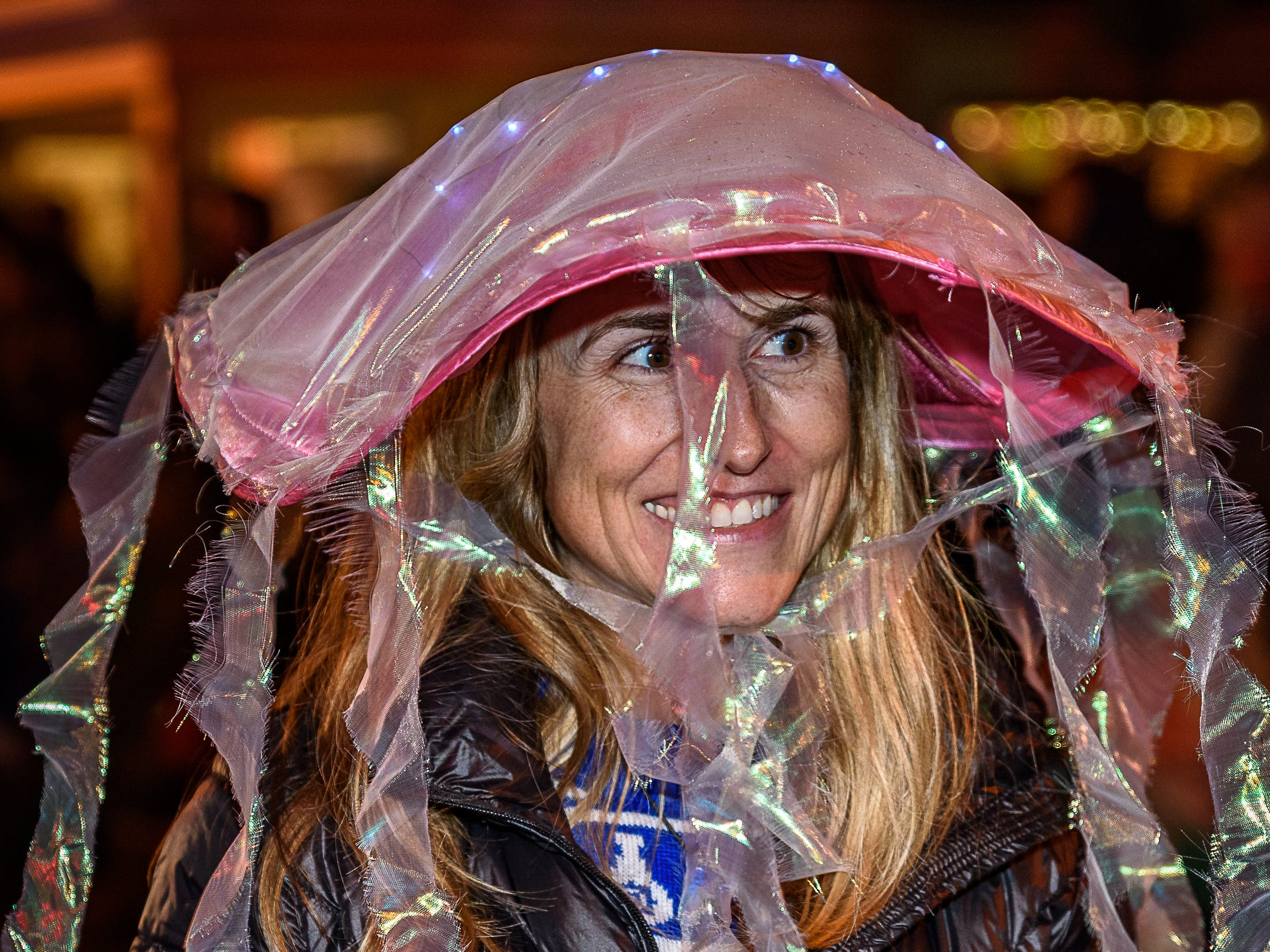 A parade participant shows off her jellyfish hat at the Chincoteague Christmas parade.