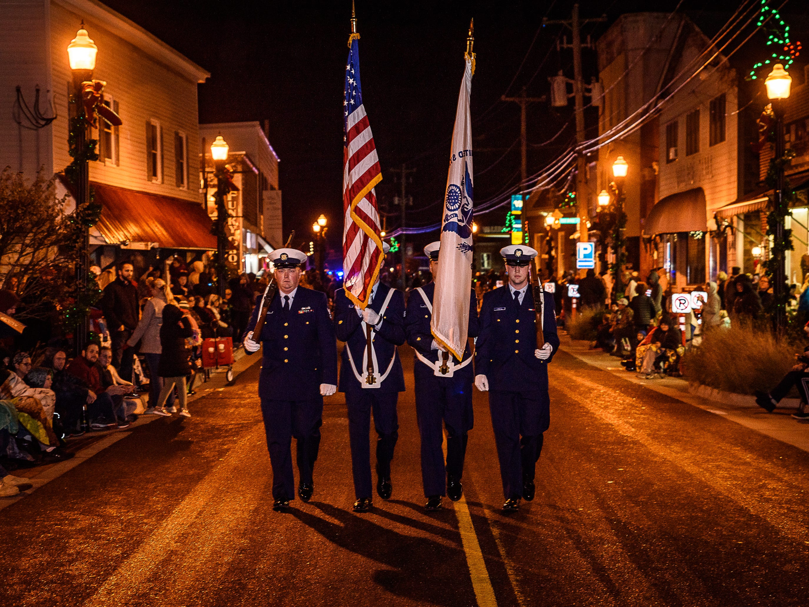 Members of the U.S. Coast Guard , Chincoteague station, carry the colors in the annual Christmas parade on Dec. 1.