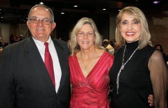 "Jim and Cindy Fortson and Debby Williams at ""Mingle & Jingle."""