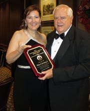 Shreveport Medical Society 2018 president Dr. Margaret Crittell presents Bill Huckabay the distinguished Service Honor Award at the Installation Dinner Dance. Paul L. Schuetze/The Times